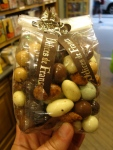 A bag of chocolate covered dried fruits and nuts