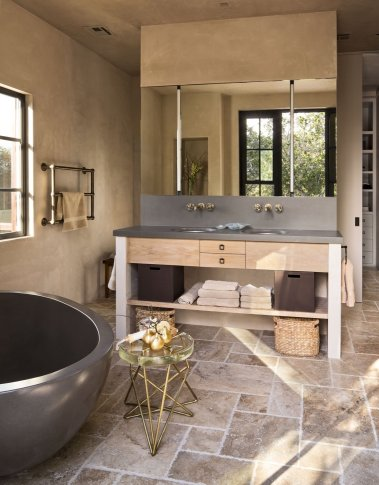 modern-bathroom-fixtures-are-paired-with-rustic-natural-materials