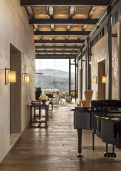 the-entry-sequence-is-lined-with-reclaimed-teak-flooring