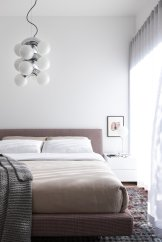 if-you-need-bedroom-lighting-ideas-for-the-ceiling-check-out-how-this-tonal-bedroom-in-vancouver-utilizes-a-modern-pendant-light-to-add-visual-interest-while-tying-perfectly-with-the-desk-lamp